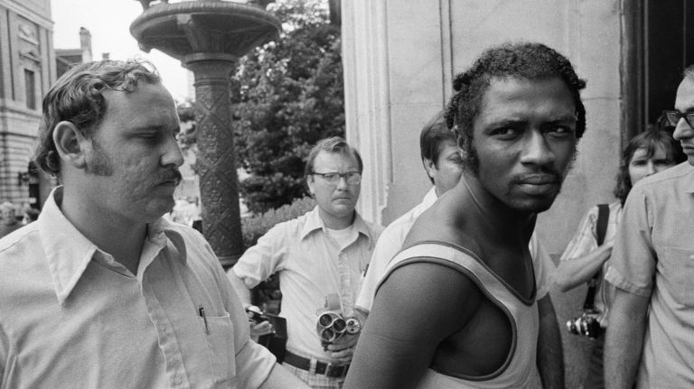 Herman Bell, seen on Sept. 1, 1973, after his arrest in New Orleans, was convicted of fatally shooting two NYPD officers in 1971. Photo Credit: AP