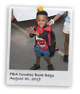 PBA Donates Book Bags to Far Rockaway's Children